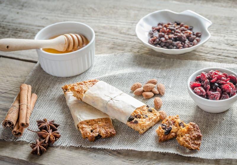 Homemade granola bars on the sackcloth. Close up stock image
