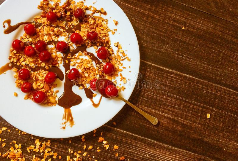 Homemade granola at black table with some milk stock photo