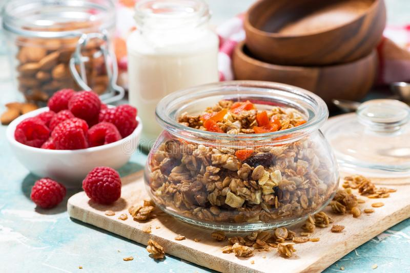 Homemade granola with dried apricots and nuts for breakfast. Closeup horizontal royalty free stock image