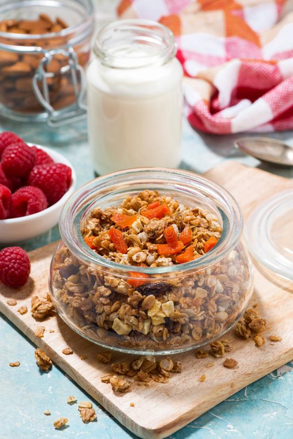 Homemade granola with dried apricots and nuts, vertical. Top view royalty free stock photography