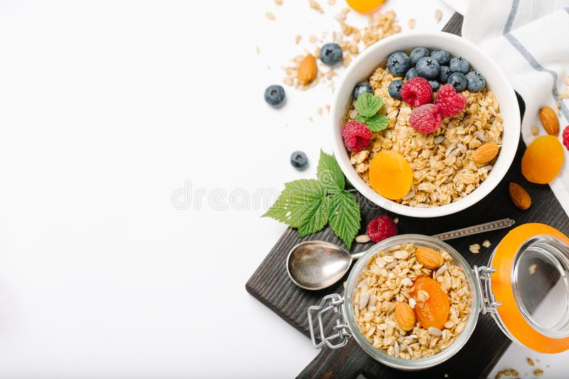 Homemade granola with dried fruit and berries on white background royalty free stock images
