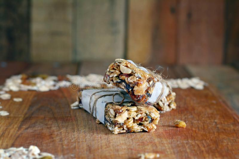 Homemade granola energy bars with figs, oatmeal, almond, dry cranberry, dates, nuts, raisins, sesame and healthy snack royalty free stock photos