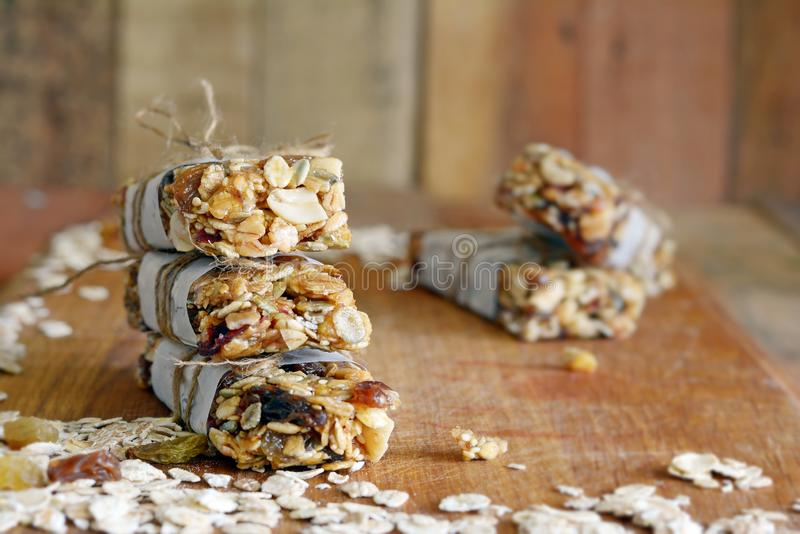 Homemade granola energy bars with figs, oatmeal, almond, dry cranberry, dates, nuts, raisins, sesame and healthy snack. Top view, copy space. Snack food. Snack stock photos