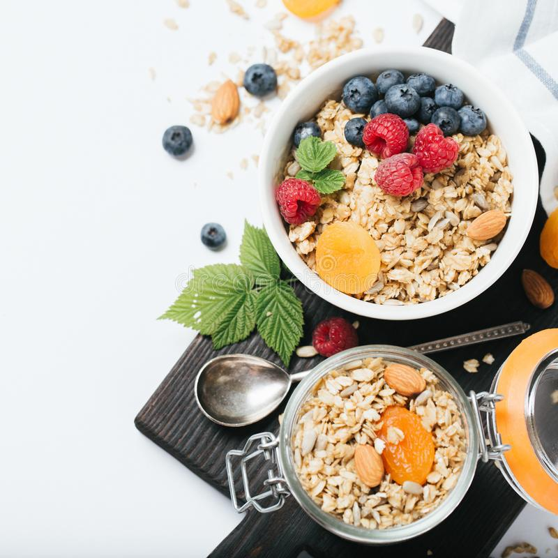 Homemade granola with dried fruit and berries on white background royalty free stock photo