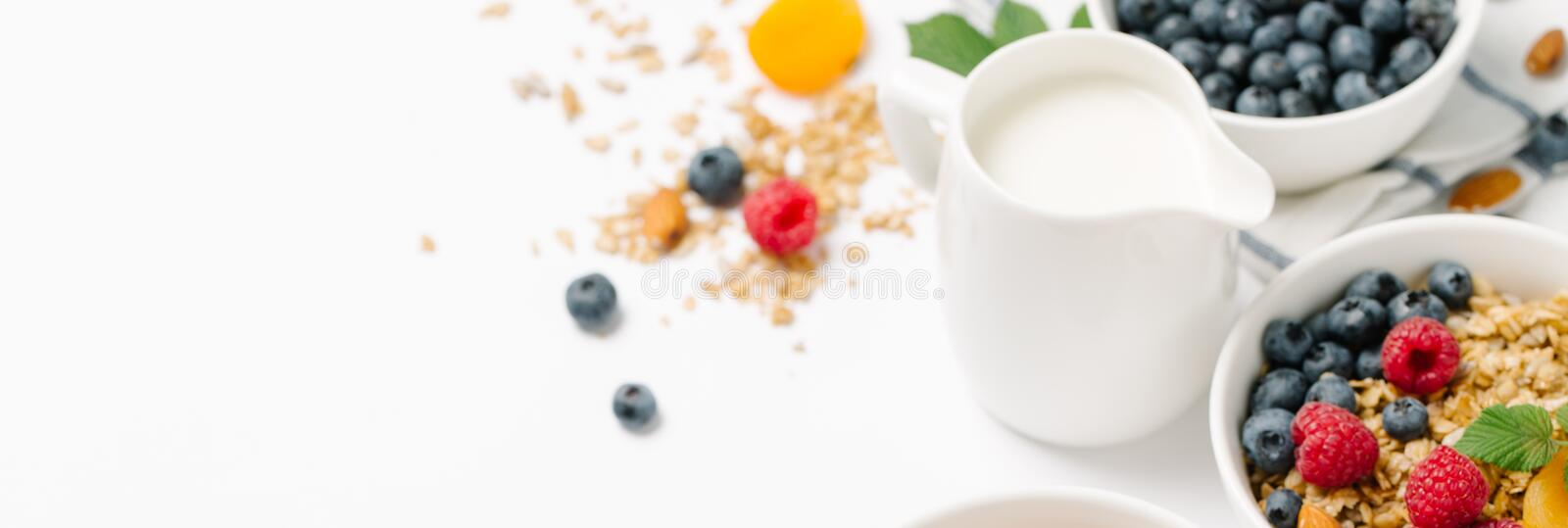 Homemade granola with dried fruit and berries on white background stock photo