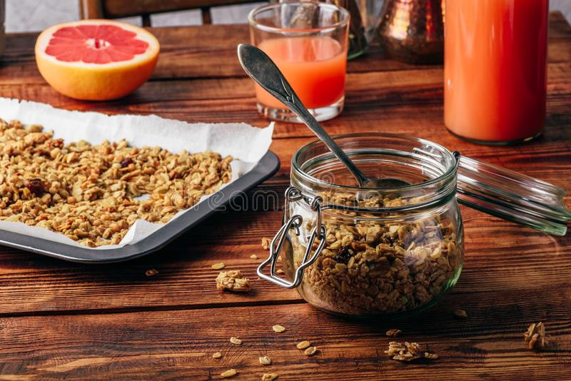Homemade granola in jar. For healthy breakfast stock photos