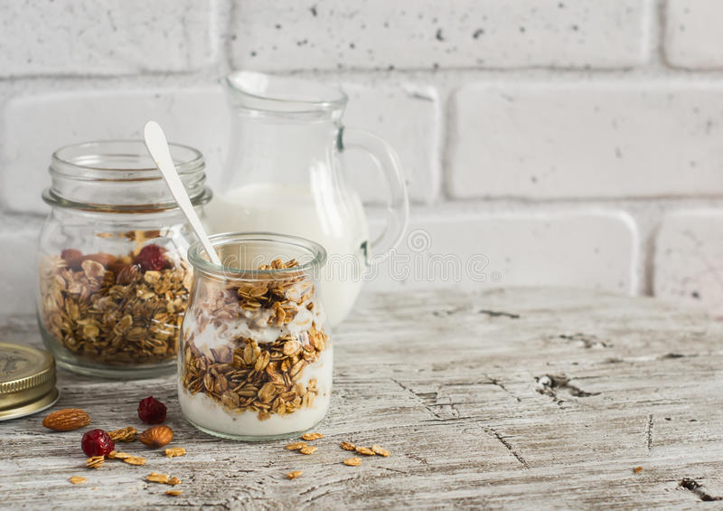 Homemade granola and natural yoghurt on a light wooden surface. Healthy food, healthy Breakfast. Or snack stock photo