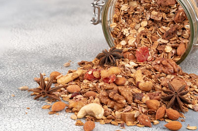 Homemade granola in open glass jar on light background royalty free stock photo