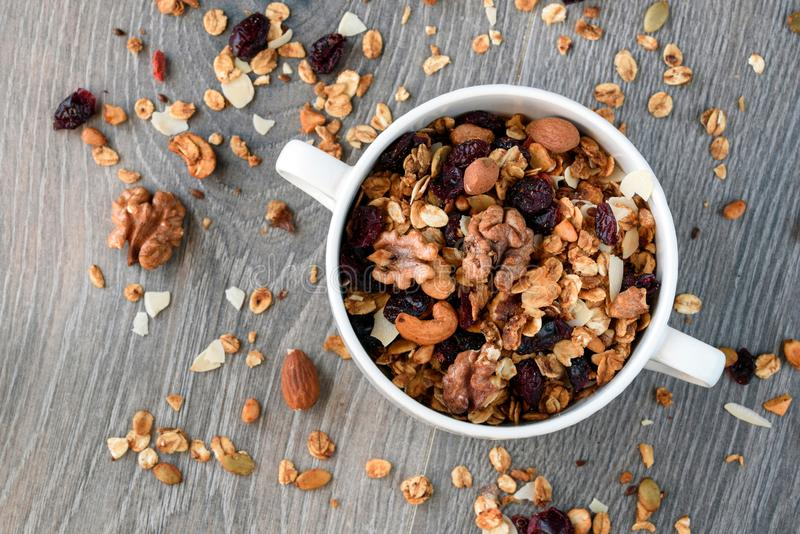 Homemade granola in white bowl.  royalty free stock photos
