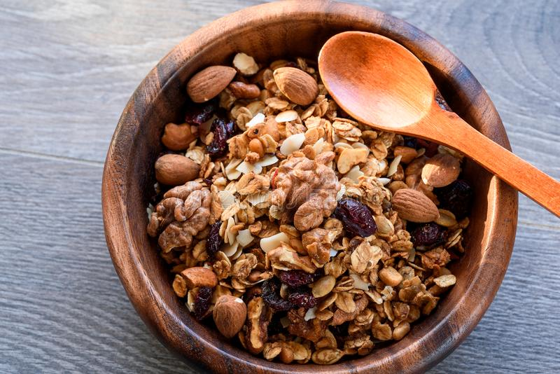 Homemade granola in wooden bowl.  royalty free stock images