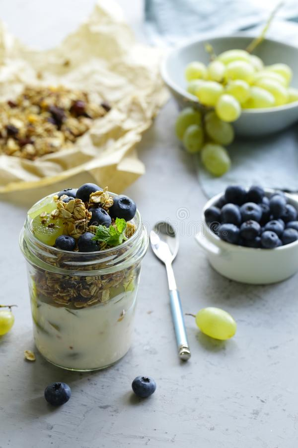 Homemade granola with yogurt and fruit. Healthy breakfast stock photos