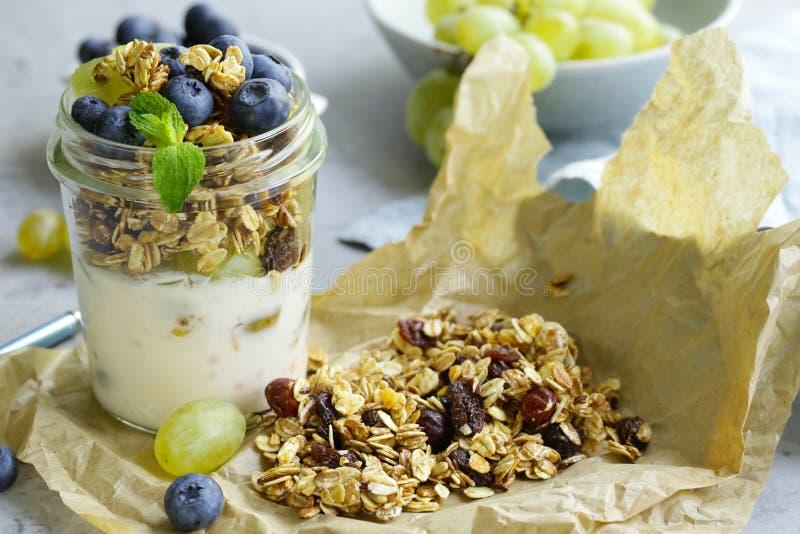 Homemade granola with yogurt and fruit. Healthy breakfast stock photo