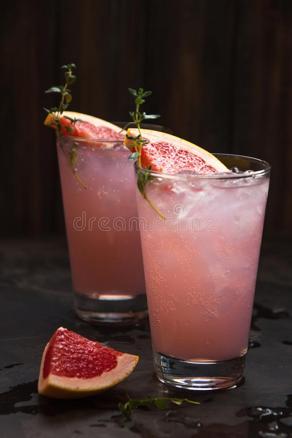 Homemade grapefruit lemonade with ice in glass royalty free stock photography