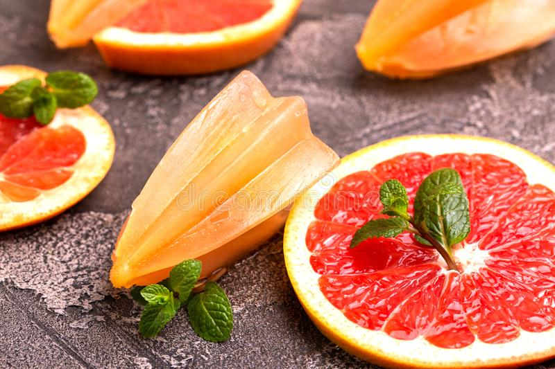 Homemade grapefruit popsicle with ripe grapefruit slices and fresh mint royalty free stock photo