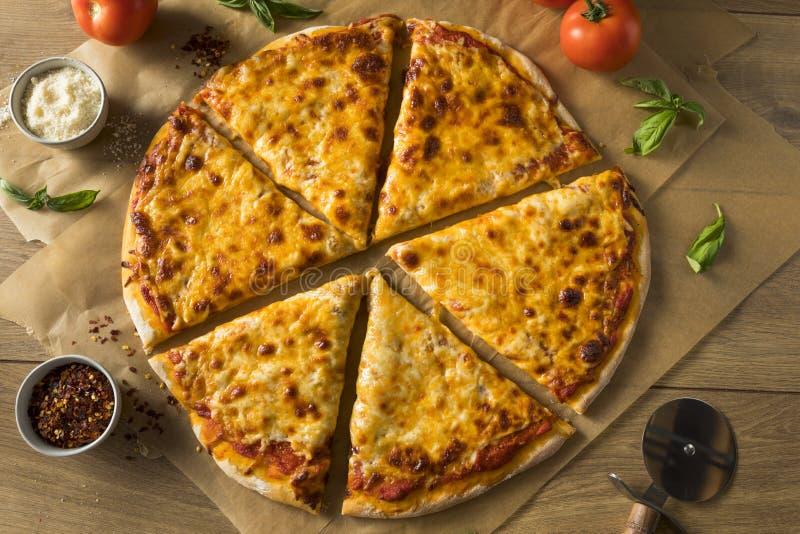 Homemade Greasy New York Cheese Pizza. Ready to Eat royalty free stock photos
