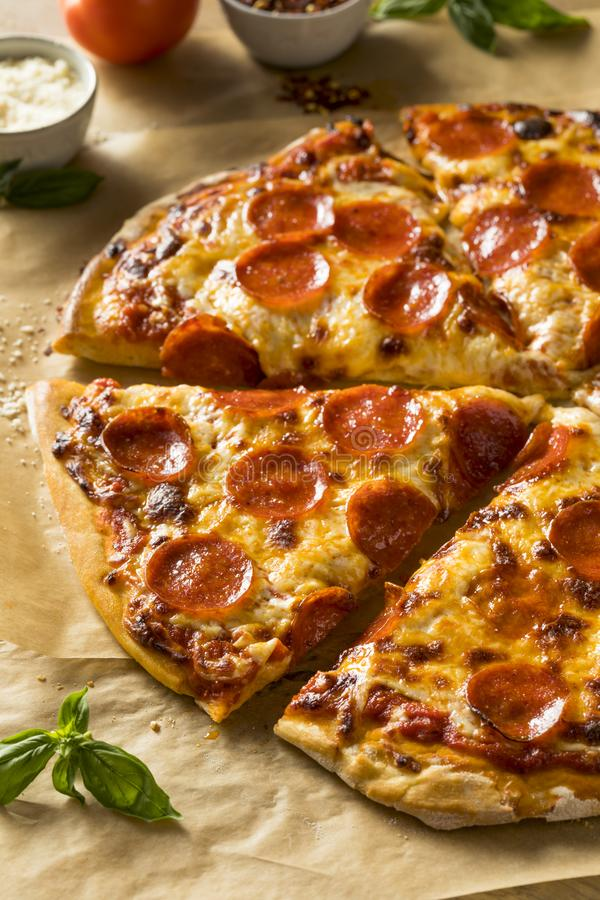 Homemade Greasy Pepperoni New York Pizza. Ready to Eat stock photo