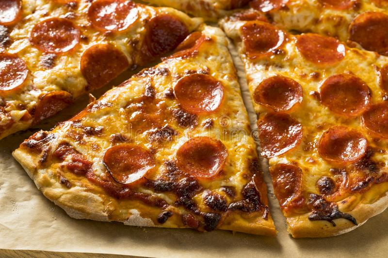 Homemade Greasy Pepperoni New York Pizza. Ready to Eat royalty free stock photo