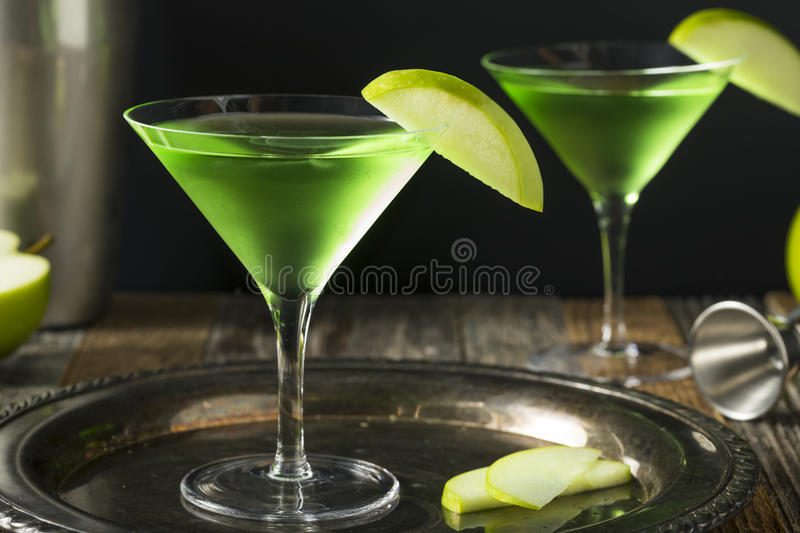 Homemade Green Alcoholic Appletini Cocktail. With Apple Garnish royalty free stock photos