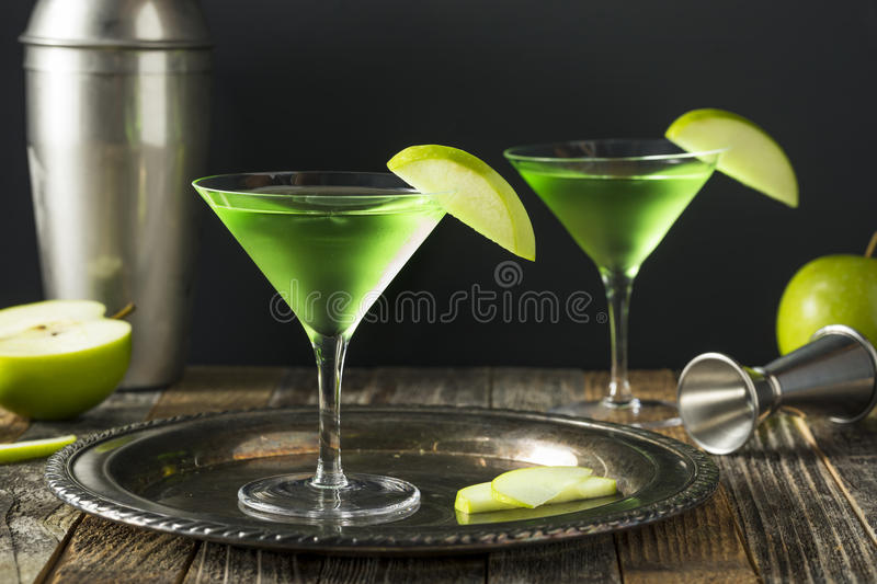 Homemade Green Alcoholic Appletini Cocktail. With Apple Garnish royalty free stock photography