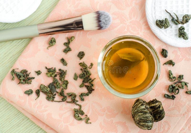 Homemade green tea face toner. Diy cosmetics recipe. Natural beauty treatment. Top view, copy space. Homemade green tea face toner. Diy cosmetics recipe royalty free stock photography