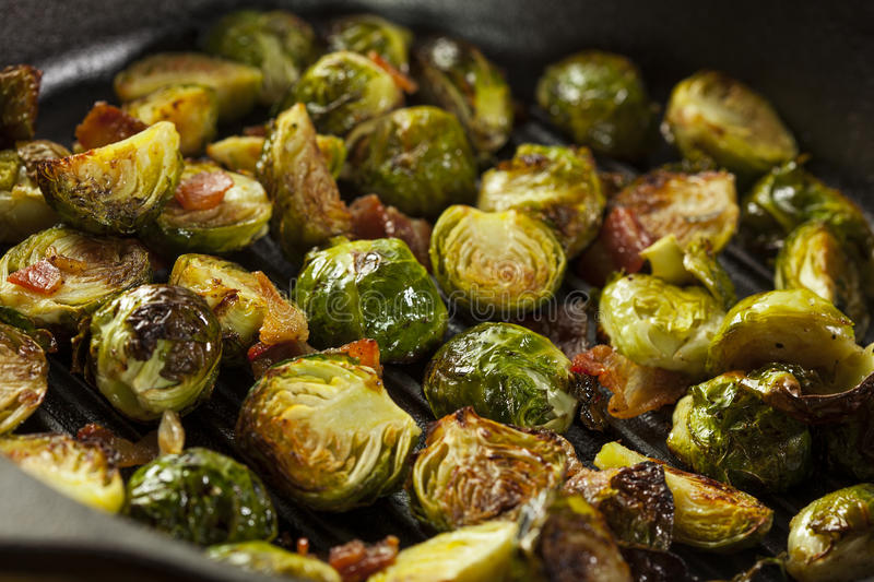 Homemade Grilled Brussel Sprouts. With Fresh Bacon royalty free stock image