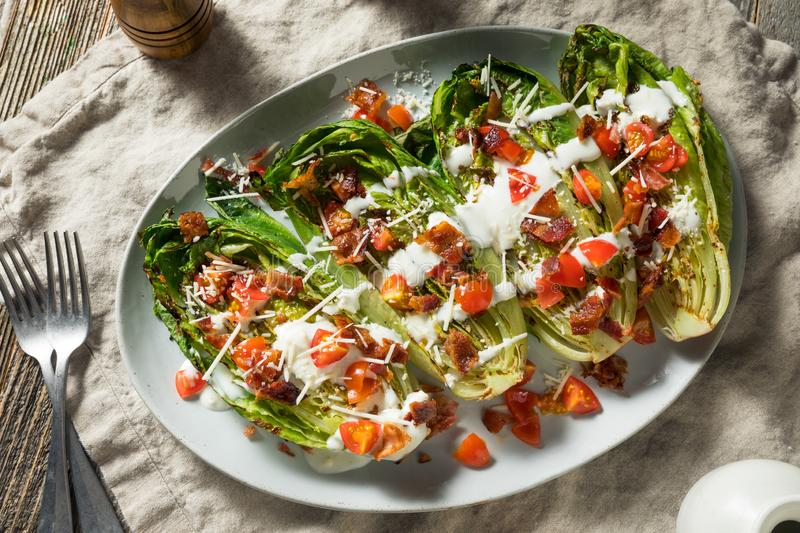 Homemade Grilled Romaine Blue Cheese Salad. With Bacon and Cheese stock image