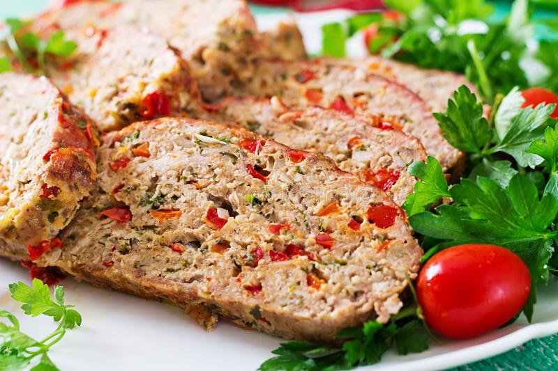 Homemade ground beef meatloaf with ketchup and bell peppers. royalty free stock images