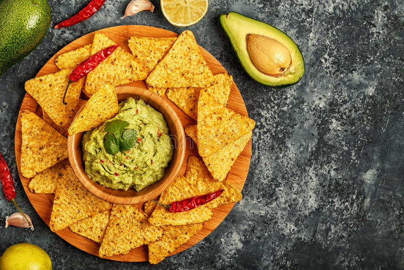 Homemade guacamole with nachos. stock image
