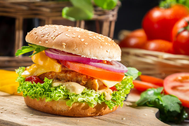 Homemade hamburger with chicken, tomato and onion royalty free stock photography