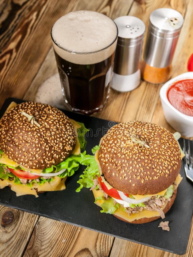 Homemade hamburger with dark beer, sauce and spices. Vertical shot stock photos