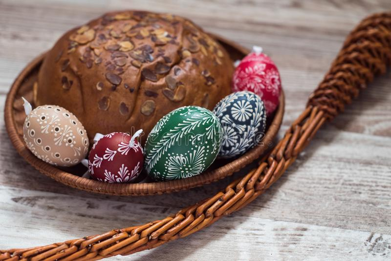 Homemade and handmade Easter eggs on birch branches on wooden tray, traditional czech, Easter egg hunt, whip with ribbons royalty free stock photos