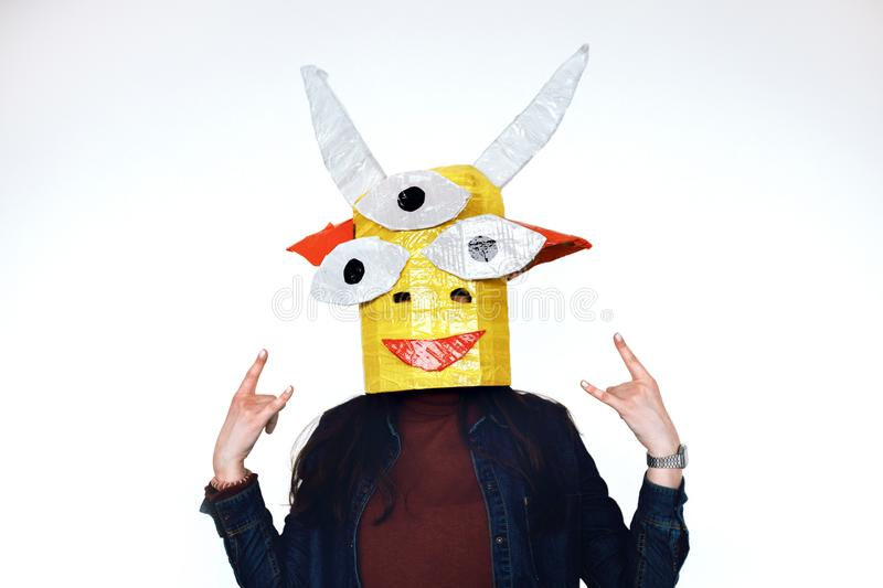 Homemade head of a fairy creature on human. Homemade head of a fairy creature is put on a human monster of cardboard and scooping on a white background royalty free stock photography