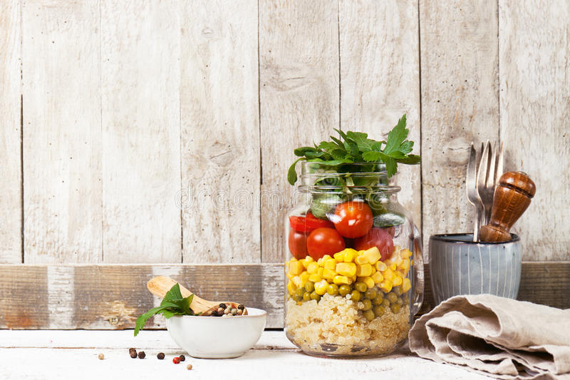Homemade healthy layer salad in mason jar on a wooden background. Healthy life, food, detox concept stock photo