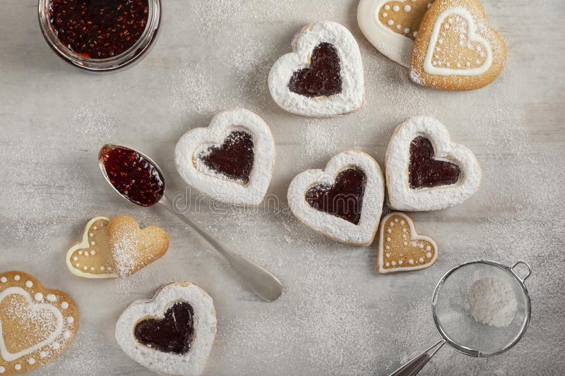 Homemade heart shaped  cookies with raspberry jam on white wooden table  for Christmas or  Valentine`s day. stock image