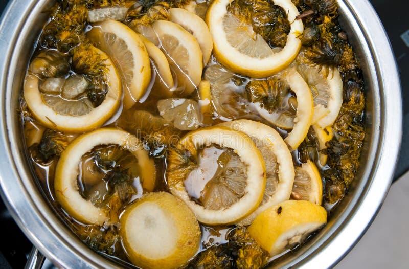 Homemade herbal drink of dandelions and lemons stock images