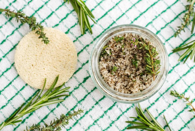 Homemade herbal scrub foot soak or bath salt with rosemary, thyme, sea salt and olive oil. Natural skin and hair care. DIY beauty treatments and spa recipe stock image