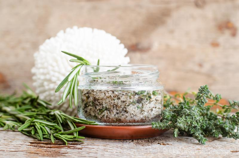 Homemade herbal scrub with rosemary, thyme,  lime juice, sea salt and olive oil. Natural skin and hair care. DIY beauty treatments. And spa recipe. Copy space stock image