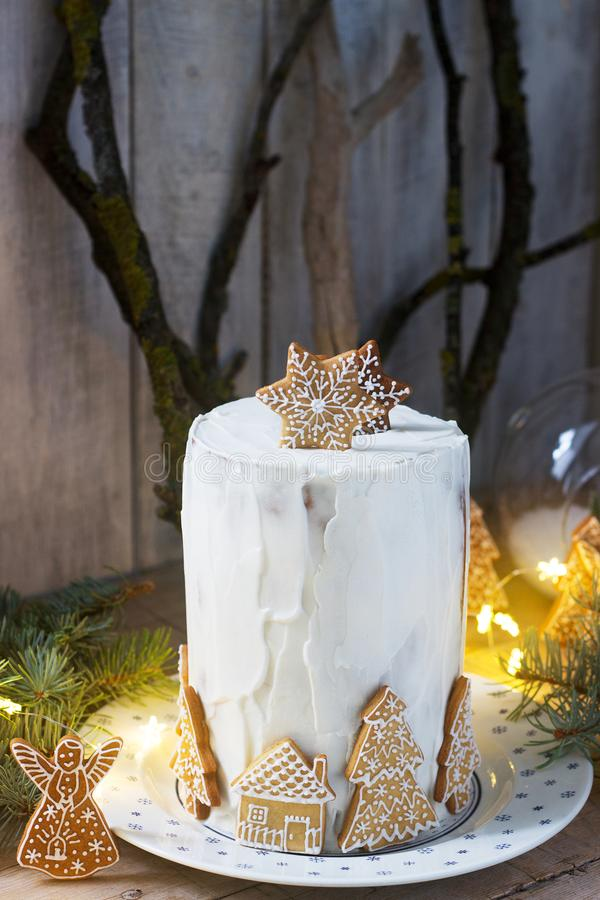 Homemade honey cake with sour cream, decorated with gingerbread. Rustic style. Festive decoration stock photos