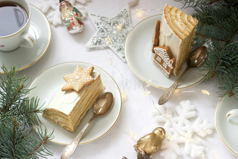 Homemade honey cake with sour cream, decorated with gingerbread. Rustic style. Festive decoration stock images