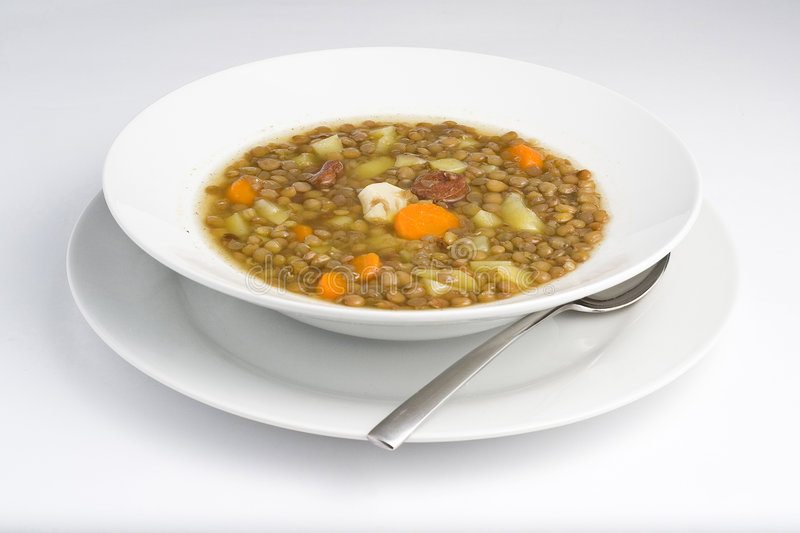 Homemade hot dish of lentils. Isolated on white stock photos