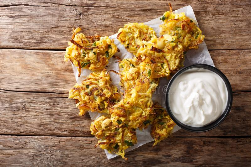 Homemade Indian fried onion bhaji with yogurt close-up. Horizontal top view. Homemade Indian fried onion bhaji with yogurt close-up on the table. horizontal top royalty free stock images