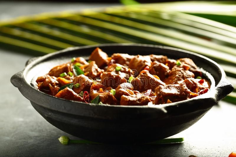 Healthy diet Indian lamb, mutton meat curry. Homemade Indian recipes- lamb,mutton curry roast ,slow cooked in clay pottery stock images