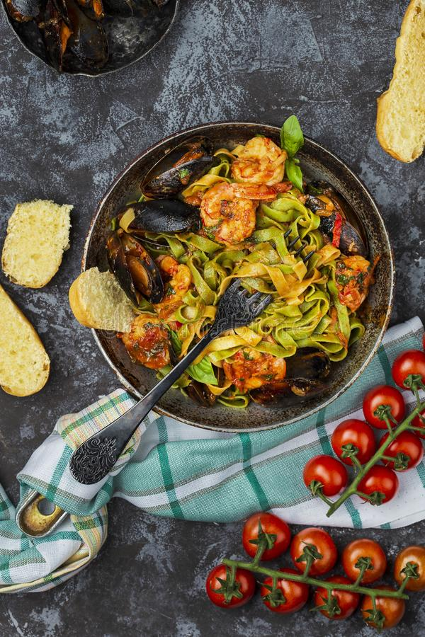 Homemade Italian Seafood Pasta with Mussels and Shrimp. Homemade Italian Seafood Pasta tagliatelle with Mussels and Shrimp stock photo