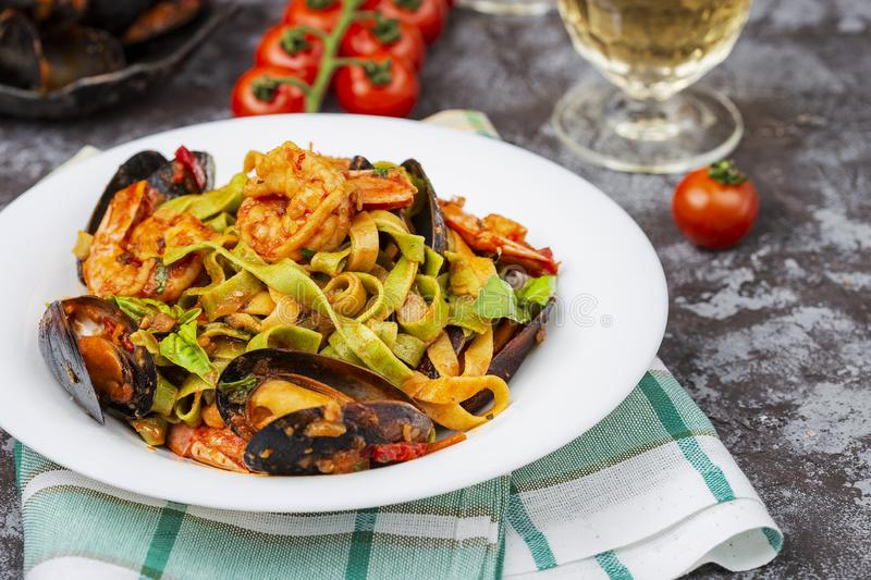 Homemade Italian Seafood Pasta with Mussels and Shrimp. Homemade Italian Seafood Pasta tagliatelle with Mussels and Shrimp stock image