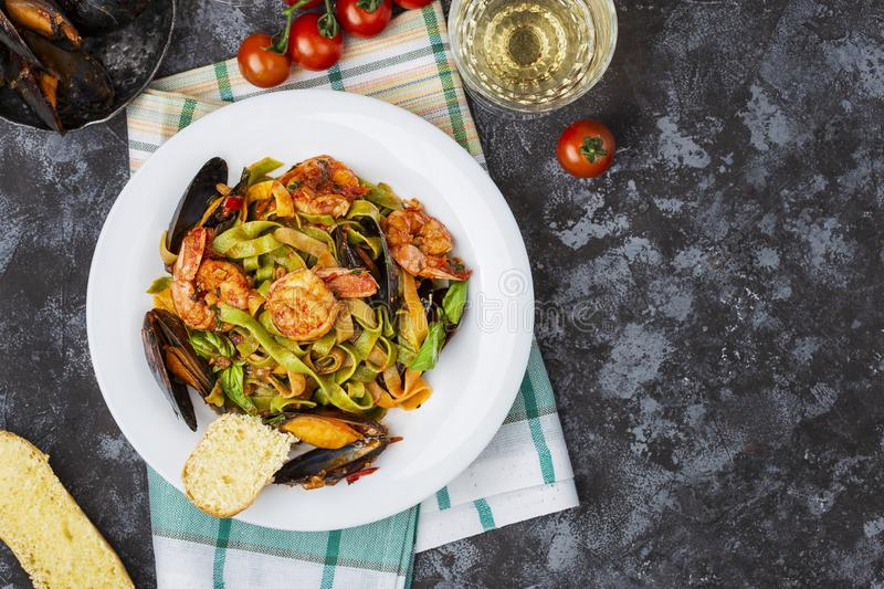 Homemade Italian Seafood Pasta with Mussels and Shrimp. Homemade Italian Seafood Pasta tagliatelle with Mussels and Shrimp royalty free stock images