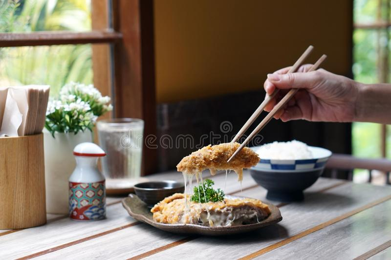 Homemade Japanese deep fried breaded pork tenderloin or cutlet stuffed with cheese, served with tonkatsu sauce. stock photography