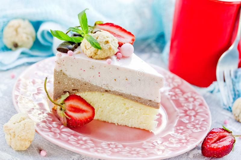 Homemade layered strawberry chocolate mousse cake stock image