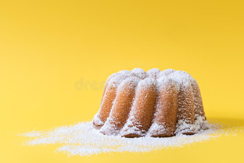 Homemade lemon bundt cake with icing sugar. royalty free stock photography