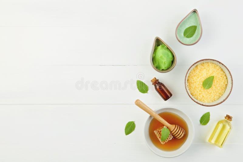 Homemade lemon essential oil, salt bath and fresh honey in the p royalty free stock photography