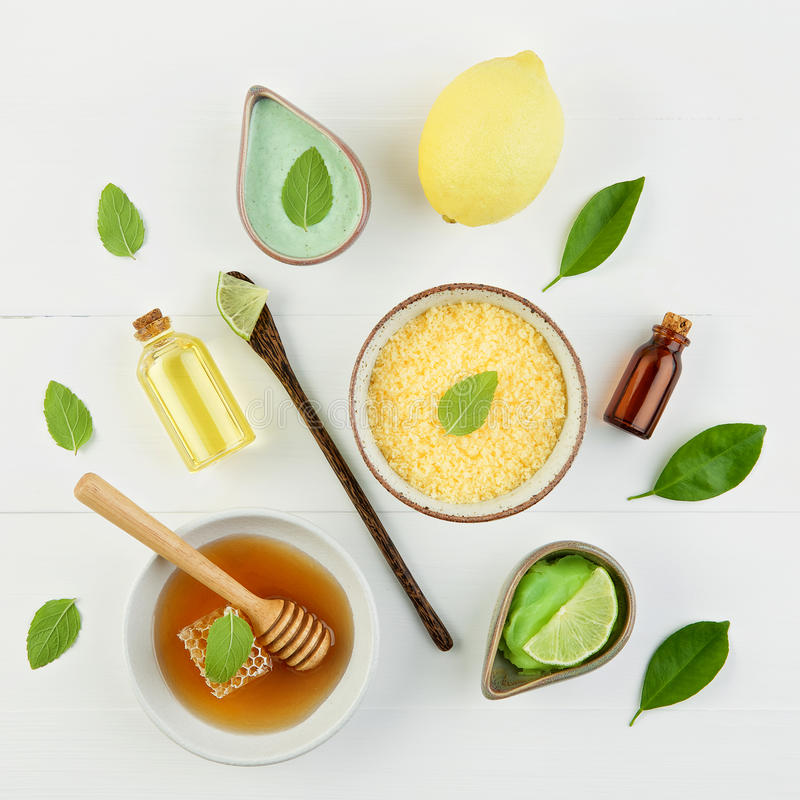 Homemade lemon essential oil, salt bath and fresh honey in the p royalty free stock image